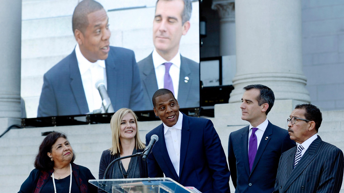 """Rapper Jay Z will bring his Budweiser Made in America festival to the 12-acre Grand Park in downtown LA. He calls it """"inclusionary,"""" but not everyone agrees."""