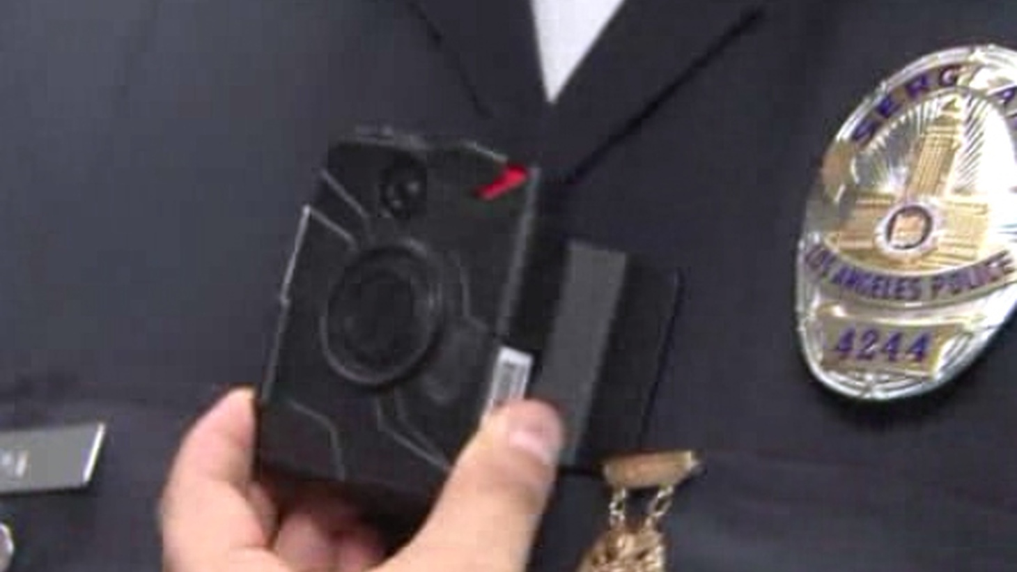 "The LAPD has taken another step toward being the nation's largest law enforcement agency to put body cameras on officers, but it didn't happen without an argument. The Police Commission says they'll provide clarity in controversial incidents and greater accountability. The ACLU agrees with the goal but says the Commission's policy ""will likely do more harm than good."""