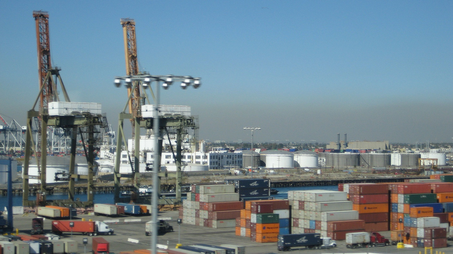 Retailers and agricultural interests are warning about a possible West Coast shipping strike or a lockout that could cost the economy billions. They've asked the President to step in. We hear from dockworkers and shippers about a slowdown that's already under way.