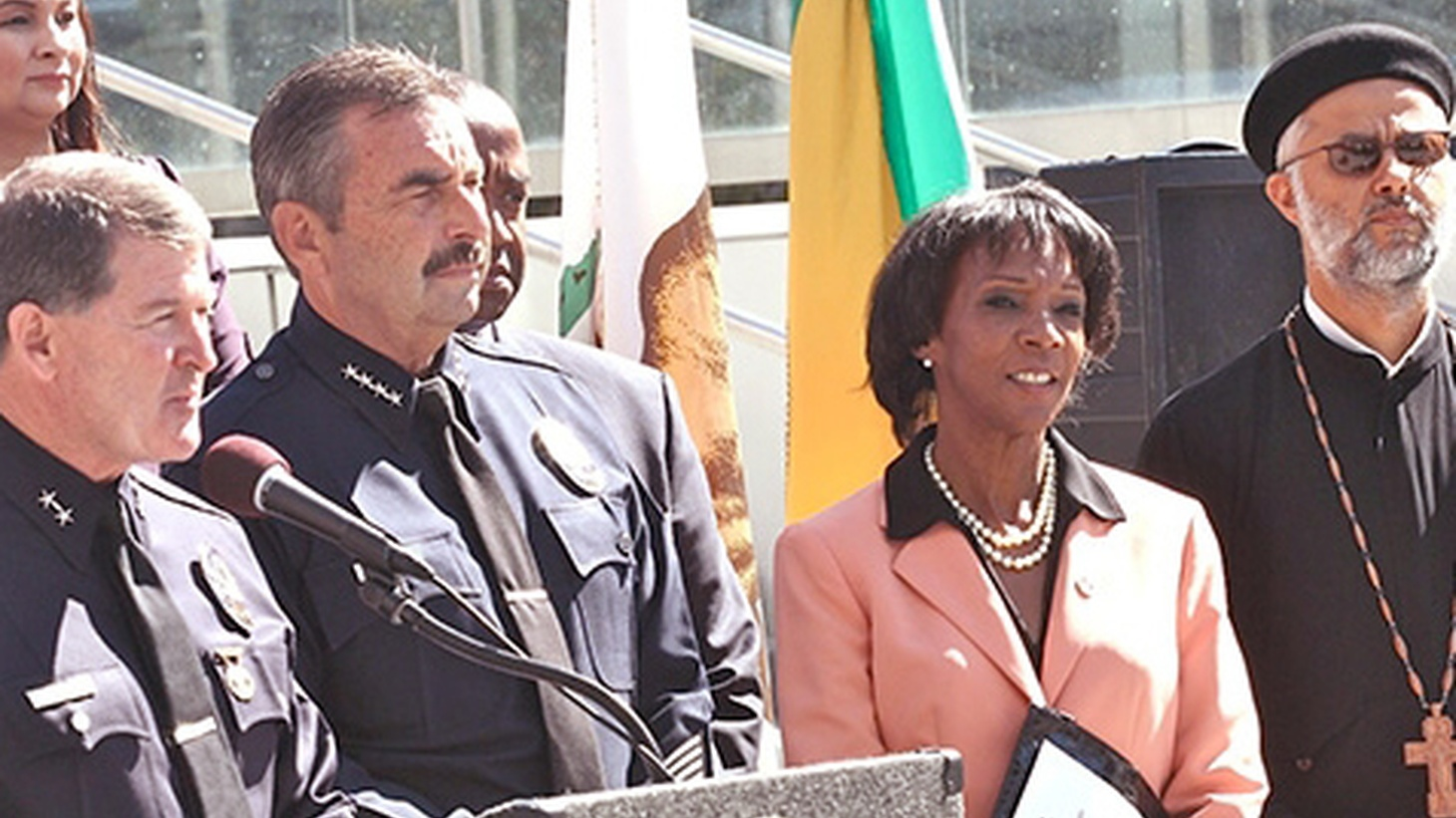 LA County District Attorney Jackie Lacey faces no credible challenger yet in this year's bid for re-election, but she is facing increased political pressure. LAPD Chief Charlie Beck wants her to file charges against one of his own officers in a controversial killing — an action he's never taken before. Political activists are waiting for her decision.
