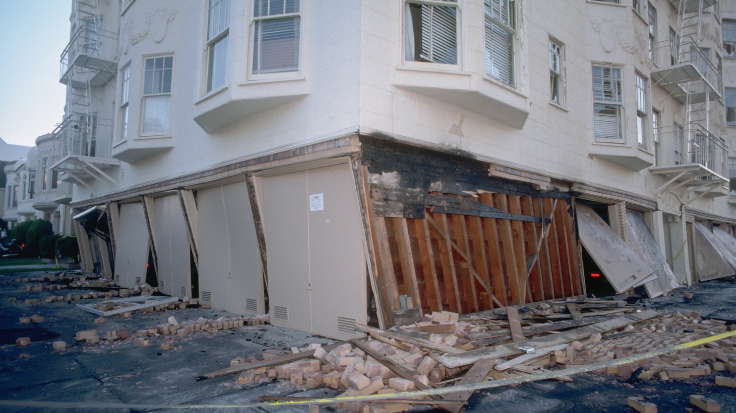 """When the Sylmar Earthquake brought down concrete apartment houses, 52 people were killed. Sixteen lost their lives when wooden, """"soft story"""" buildings collapsed during the Northridge quake. Today, LA City Council members are looking at earthquake retrofitting proposals tough enough to make history. We hear what's at stake for landlords and tenants."""