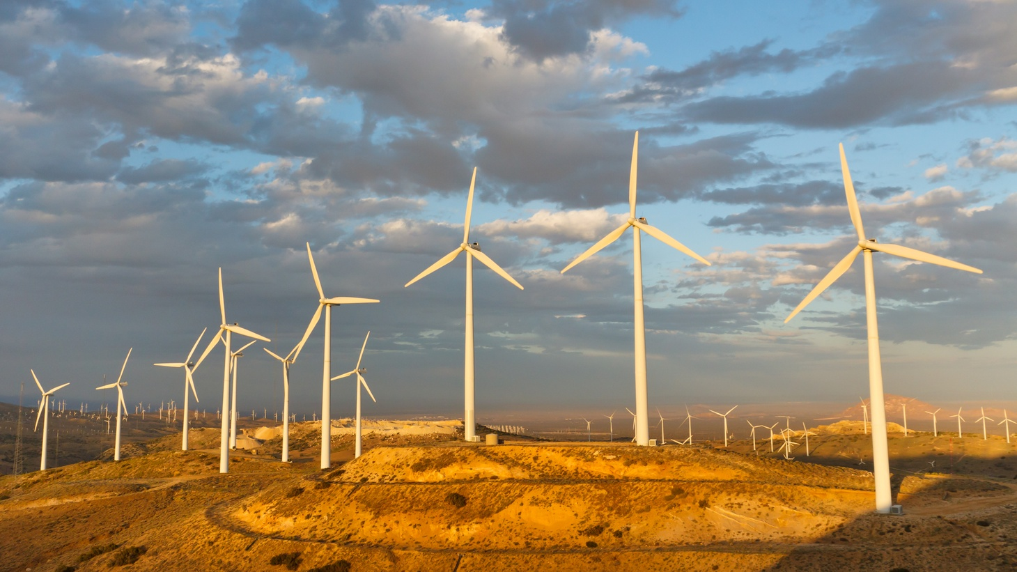 Windmills at Tehachapi Pass Wind Farm, California, generate clean renewable electrical energy without carbon dioxide emissions to fight climate change.