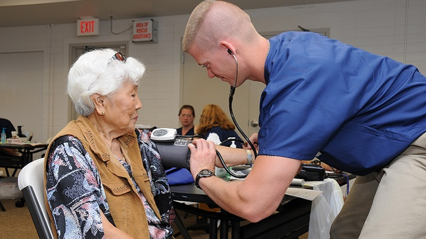 Air Force Staff Sgt. Nick Crouse, a medical technician with the 193rd Special Operations Wing's Medical Group out of Middletown, Pennsylvania, takes the blood pressure of a patient. Heart disease, diabetes, and chronic obstructive pulmonary disease are three ailments that take a huge toll on the body as it ages.