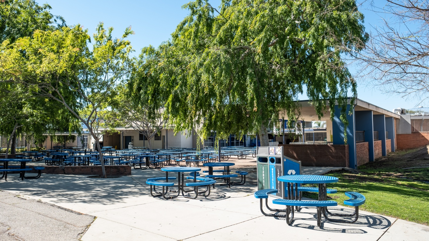 Courtyard tables sit empty at Culver City Middle School, March 1, 2021.
