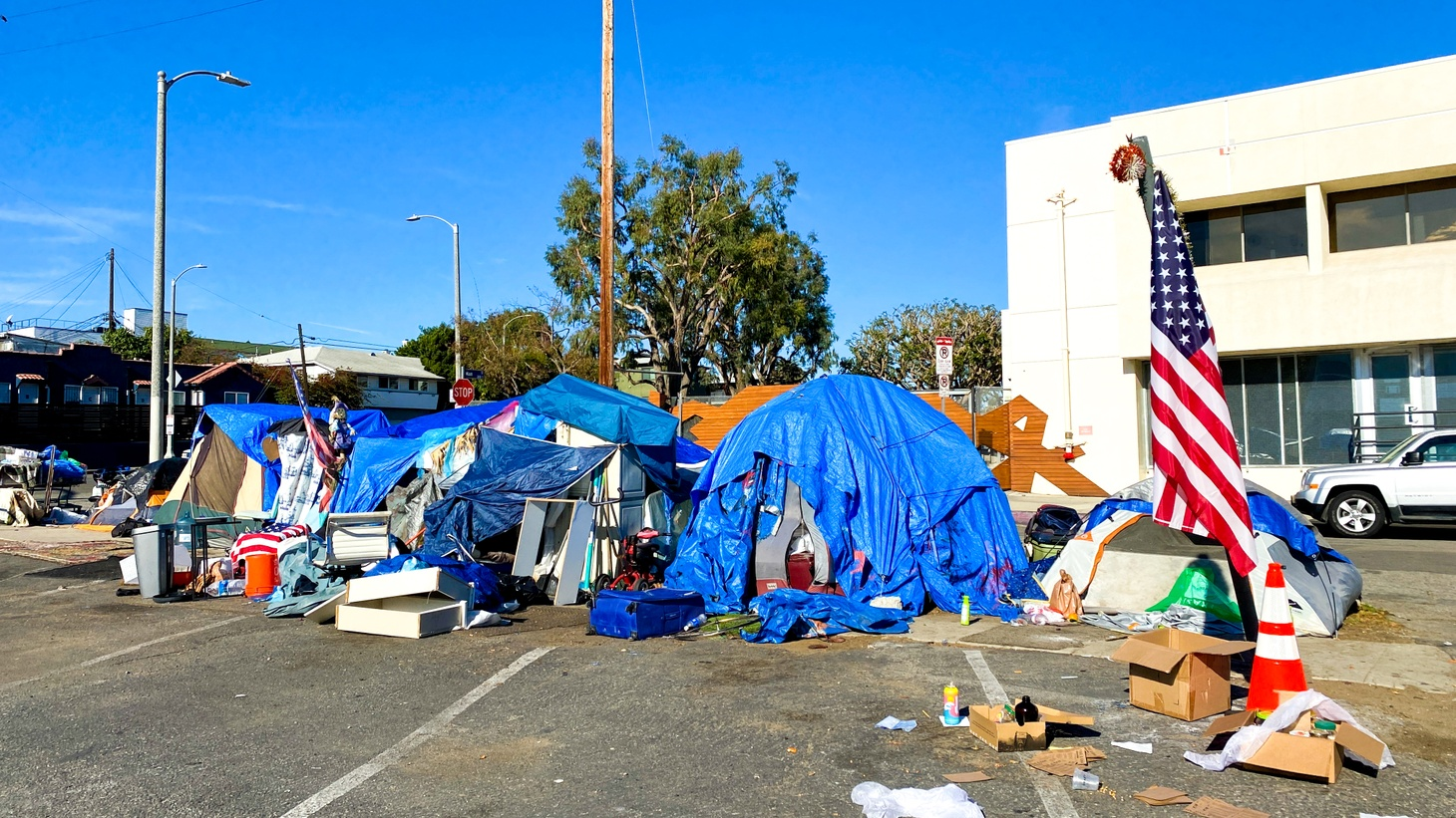 "A homeless encampment sits near Main St. in Santa Monica, February 2021. ""Pre-pandemic, LA defenders could dismiss criticism by pointing to declining crime, rising graduation rates, or ambitious plans to fight homelessness. But the coronavirus made LA's deeper problems undeniable. COVID followed the map of LA's inequality, killing at higher rates in our most overcrowded and underserved communities,"" writes Joe Mathews."